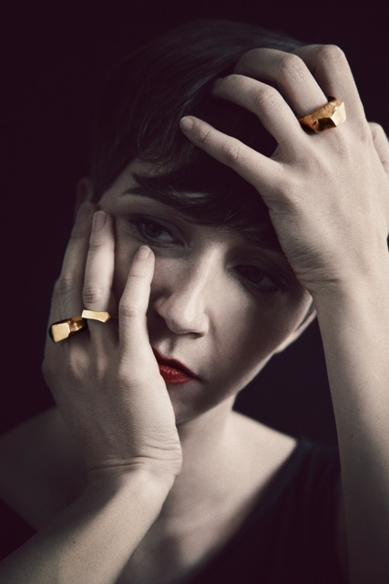 model wears Gold Asym Rings