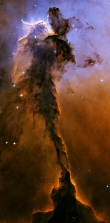 Tower of gas in the Eagle Nebula, photographed by the Hubble Space Telescope, 2005 (NASA).