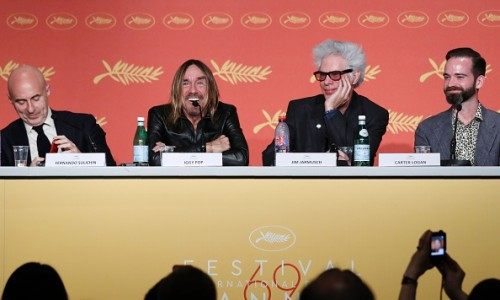 "US singer Iggy Pop (2ndL) talks on May 19, 2016 while holding with Argentinian producer Fernando Sulichin (L), US director Jim Jarmusch (C) and US producer Carter Logan a press conference for the film ""Gimme Danger"" at the 69th Cannes Film Festival in Cannes, southern France.  / AFP / Laurent EMMANUEL        (Photo credit should read LAURENT EMMANUEL/AFP/Getty Images)"