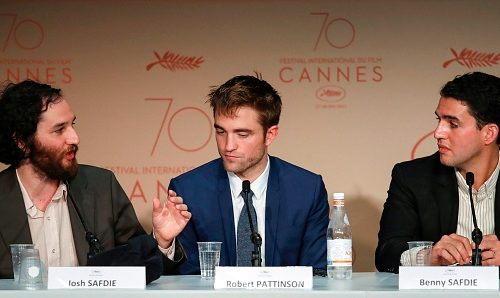 (FromL) US director Josh Safdie, British actor Robert Pattinson and US director Benny Safdie pose, on May 25, 2017 during a press conference for the film 'Good Time' at the 70th edition of the Cannes Film Festival in Cannes, southern France.  / AFP PHOTO / Laurent EMMANUEL        (Photo credit should read LAURENT EMMANUEL/AFP/Getty Images)